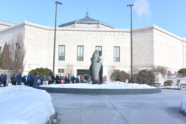Man with Fish Fountain at the entrance of the Shedd Aquarium